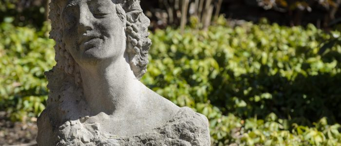 Image of statue of female head outside William Benton museum,