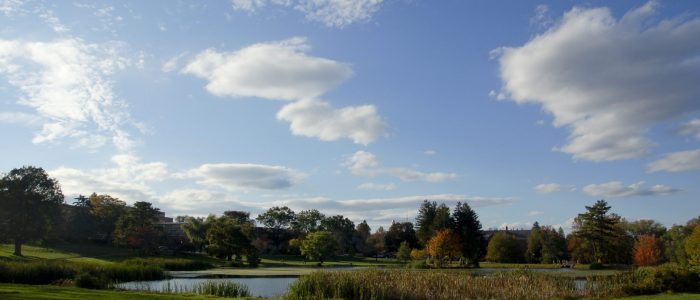 Mirror Lake under clouds on the UConn Campus.